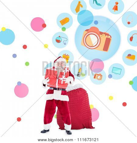 Santa holding pile of gifts against dot pattern