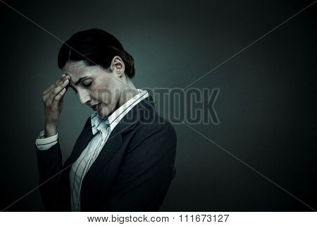 Concentrating businesswoman against grey background