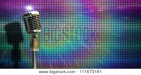 Digitally generated retro microphone on stand against digitally generated cool disco background