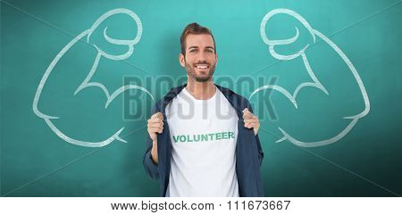 Portrait of a smiling young male volunteer against green chalkboard