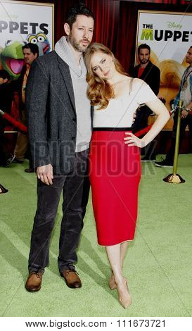 HOLLYWOOD, CALIFORNIA - November 12, 2011. Amy Adams and Darren Le Gallo at the World premiere of