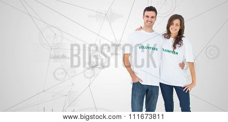 Two cheerful people wearing volunteer tshirt against interface with graphs