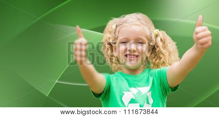 Happy little girl in green with thumbs up against abstract green design