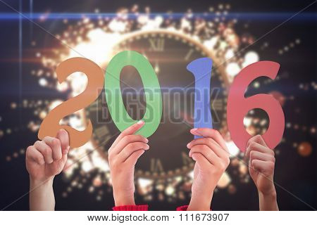 Hands showing 2016 against clock counting down to midnight