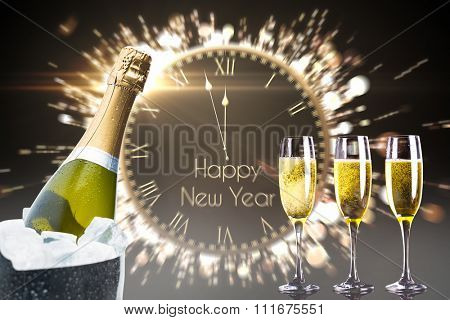 Champagne cooling in ice bucket against black and gold new year message