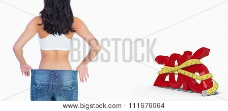 Back of woman holding her too big jeans against white background with vignette