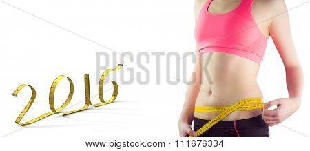 Sporty woman measuring waist over white background against white background with vignette