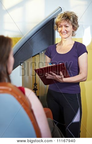 Fitness Trainer With Clipboard
