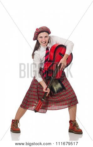 Woman in scottish clothing with guitar