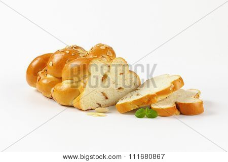 sliced sweet braided bread on white background