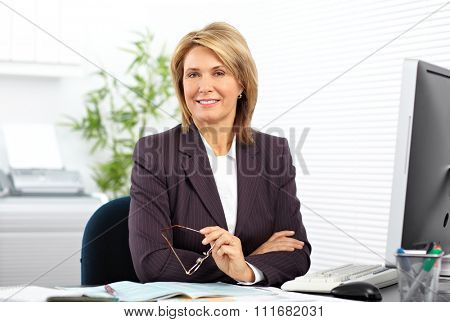 Mature business woman working with computer in the office.