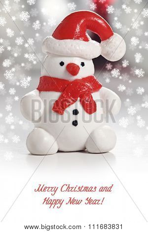 Snowman with Santa Hat. Christmas greeting card with snowflakes