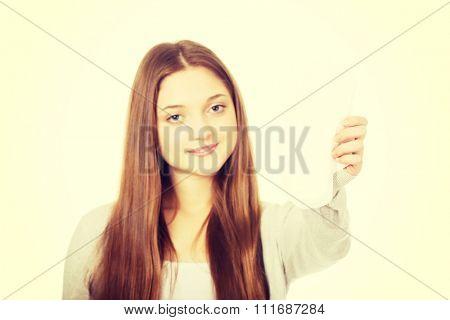 Beautiful teen woman with menstruation pad.