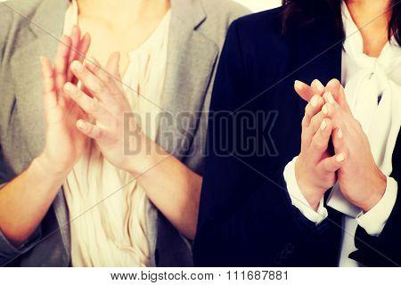 Two happy cheerful businesswomen applauding.