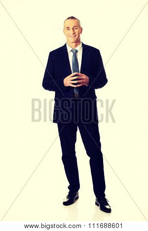 Full length confident businessman with clenched hands.