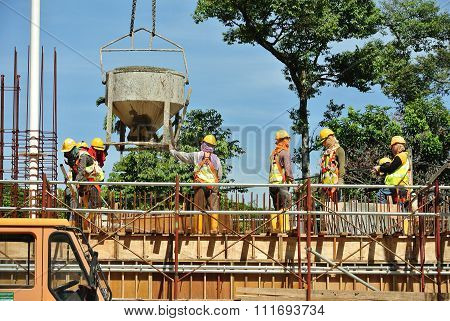 Group of construction workers concreting slab at the construction site