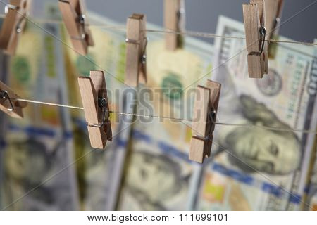 clothespins with dollars