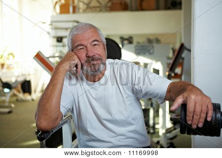Elderly Man Sitting In Gym