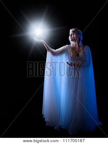 Young elven girl with star isolated on black
