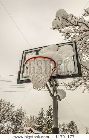 Snow-filled Basketball Net