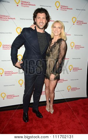 LOS ANGELES - DEC 12:  Maksim Chmerkovskiy, Peta Murgatroyd at the Childrens Miracle Network Winter Wonderland Ball, at the Avalon Hollywood on December 12, 2015 in Los Angeles, CA