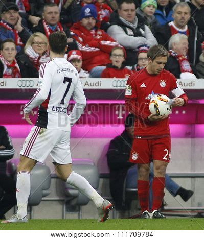 MUNICH, GERMANY - DECEMBER 12 2015: Philipp Lahm of Bayern Munich reads a note during the Bundesliga match between Bayern Muenchen and FC Ingolstadt, on December 12, 2015 in Munich, Germany.