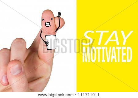 Hand crossing fingers for luck against yellow background with vignette