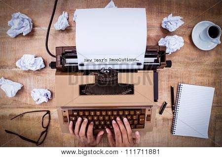 New years resolutions against above view of old typewriter