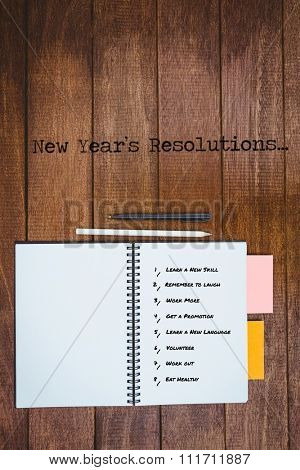 New year resolution list against white background against close up view of a workbook