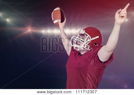 A triumph of an american football player against spotlights