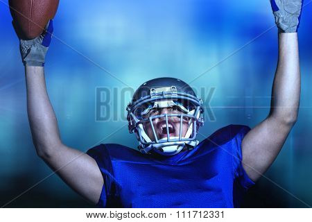 American football player in uniform cheering against blue glowing background