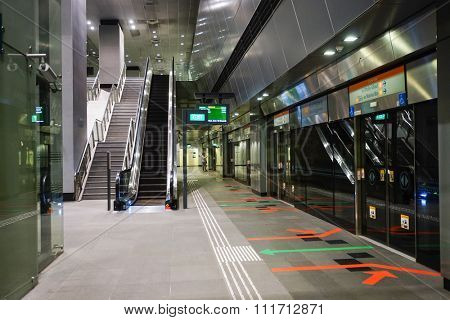 SINGAPORE - NOVEMBER 08, 2015: interior of MRT. The Mass Rapid Transit, or MRT, is a rapid transit system forming the major component of the railway system in Singapore, spanning the entire city-state