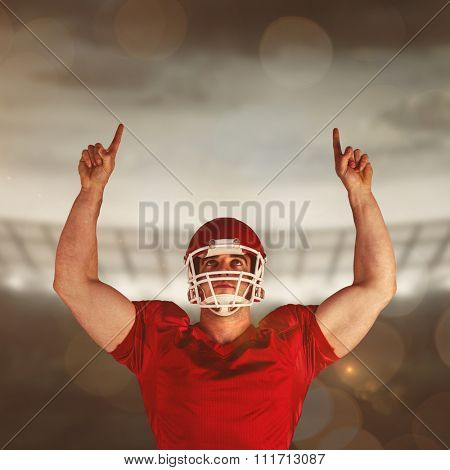 American football player cheering against rugby stadium