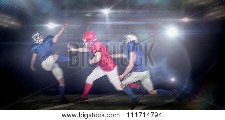 American football players against american football arena