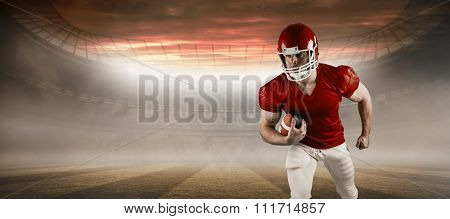 American football player running with ball against rugby pitch