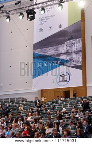 ST. PETERSBURG, RUSSIA - DECEMBER 14, 2015: People at the plenary meeting in the Atrium of General Staff Building during 4th St. Petersburg Cultural Forum dedicated to 70th anniversary of UNESCO