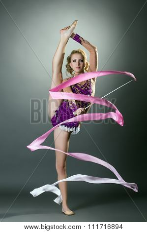Image of rhythmic gymnast performs with ribbon