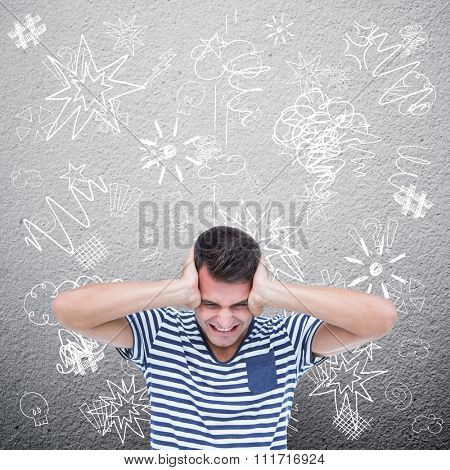 Frustrated man covering ears against grey wall