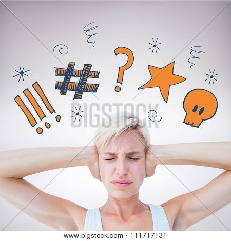 Upset woman covering her ears against grey background