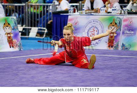 JAKARTA, INDONESIA - NOVEMBER 17, 2015: Marina Faure of France performs the movements in the women's Jianshu event at the 13th World Wushu Championship 2015 in Istora Senayan Stadium.