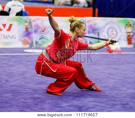 JAKARTA, INDONESIA - NOVEMBER 17, 2015: Marina Faure of France performs the movements in the women's Jianshu event at the 13th World Wushu Championship 2015 in Istora Senayan Stadium.