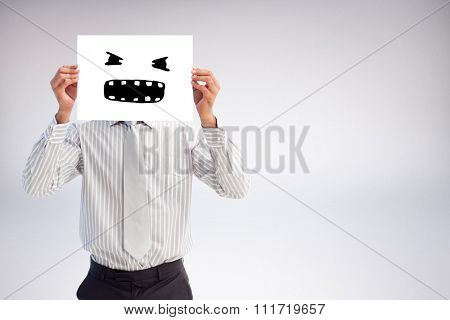 Businessman holding a white card covering his face against white background with vignette