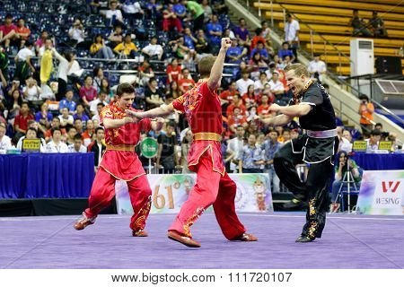 JAKARTA, INDONESIA - NOVEMBER 17, 2015: The France's men's duel team performs the action fights in the Men's Duel event at the 13th World Wushu Championship 2015 in Istora Senayan Stadium.
