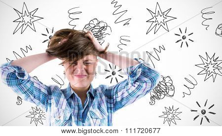 Pretty brunette getting a headache with hands on head against white background with vignette
