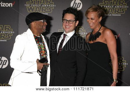 LOS ANGELES - DEC 14:  Spike Lee, JJ Abrams, Tonya Lewis Lee at the Star Wars: The Force Awakens World Premiere at the Hollywood & Highland on December 14, 2015 in Los Angeles, CA