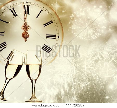 Glasses with champagne against clock and holiday background