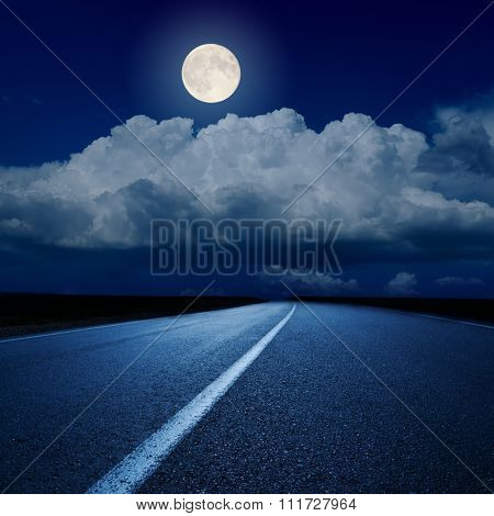 full moon over clouds and asphalt road