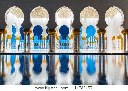 ABU DHABI, UAE - MARCH 27, 2014: Columns of  Sheikh Zayed Grand Mosque in Abu Dhabi, UAE. Grand Mosque in Abu Dhabi is the largest mosque in the United Arab Emirates for more than 40,000 prayers.