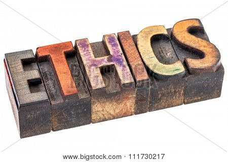 ethics word abstract - an isolated banner in vintage letterpress wood type blocks stained by color inks