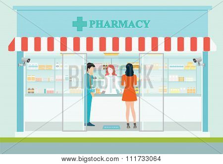 Female Pharmacist At The Counter In A Pharmacy.
